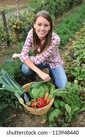 Woman knelt in vegetable garden