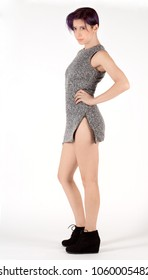 Woman in Knit Gray Mini Dress With Zippers