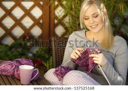 Woman knitting on terrace