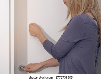 Woman knocking on door before entering, Personal Space concept. Family Behavior Rules during Coronavirus Lockdown