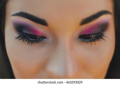 Woman of the Korean race, close. Pink shadows, beautiful eyes. Make-up