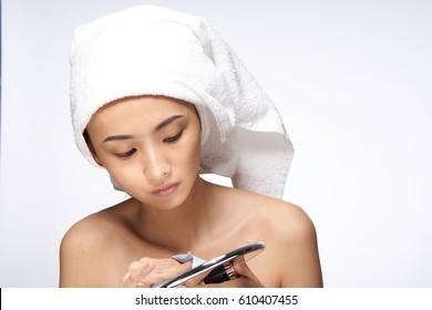 Woman Korean woman with towel on her head clean skin
