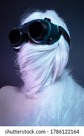 woman l in dark glasses and wrapped hair around her head
