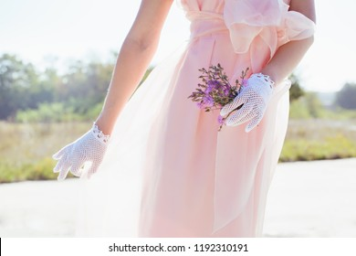 Woman in lacy white gloves handmade in retro style
