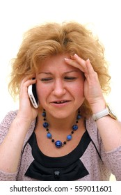 woman laments on phone