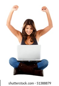 Woman with a laptop enjoying her online success - isolated over white