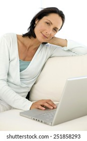 Woman with laptop at home - portrait