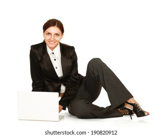 A woman with a laptop sitting on the floor, isolated on white background