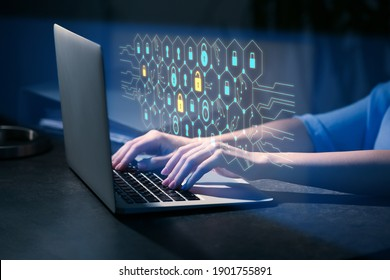 Woman with laptop using software for data protection on dark background