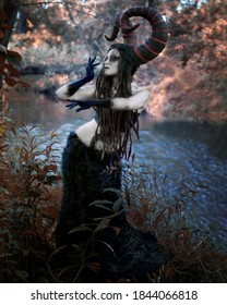 Woman with large faun horns on her head by the river