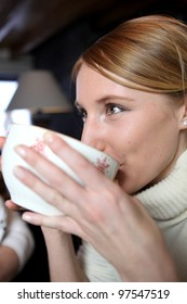 Woman from large mug