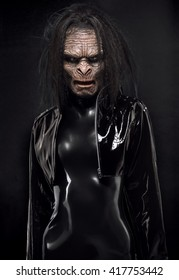 Woman in latex clothes with ape mask on face