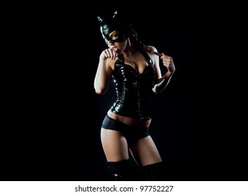 woman in latex and leather black cat costume