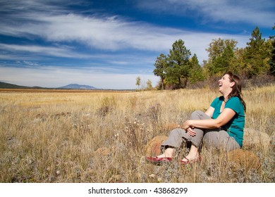 Woman Laughing in Field
