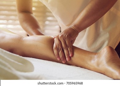Woman laying down on a spa massage bed.
