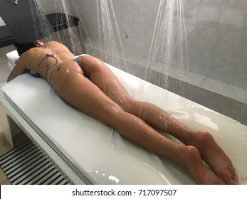Woman laying down table for spa treatment