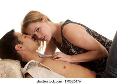 A woman is laying on a man and looking up.