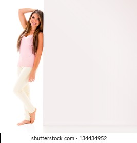 Woman leaning on a banner - isolated over a white background