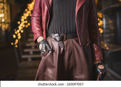 Woman with leather belt and gloves fashion look