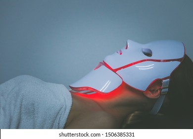 woman  with led light therapy facial and neck  beauty mask photon therapy