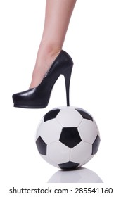 Woman leg with football isolated on white