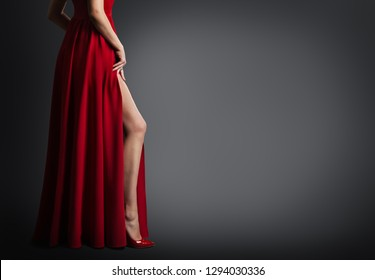 Woman Leg and Red Dress Isolated on Black Background, Sexy Fashion Model Legs in Shoes, Body Beauty