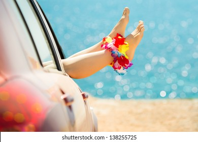 Woman legs against emerald sea and beach background. Summer vacations concept