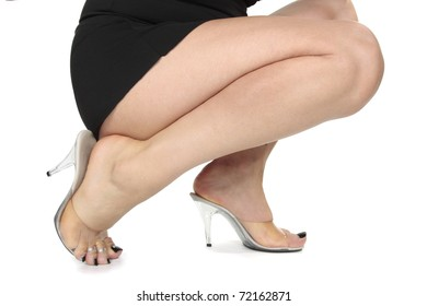 Woman legs black dress heels over white