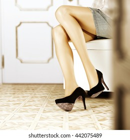 woman legs and black sexy heels and floor