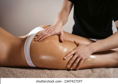 Woman legs. Body care. Beautiful woman getting anti cellulite leg oil massage treatment in spa salon. Skin care, fat burning, weight loss, wellness, lifestyle, relaxing procedure.