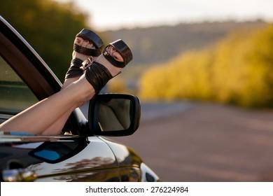 Woman legs from a car window