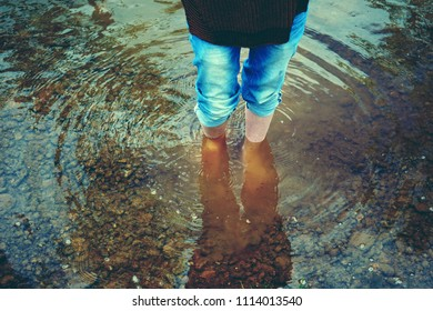 Woman legs in cold water