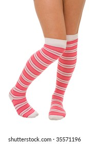 woman legs in color pink socks isolated on white