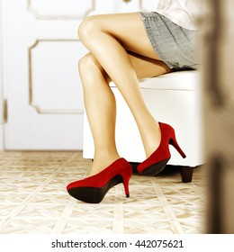 woman legs and decoration of red heels and wall