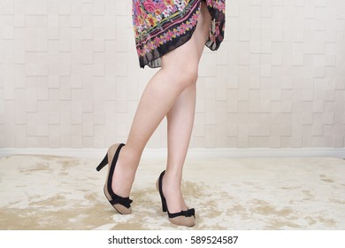 Woman legs in fashionable high heel shoes