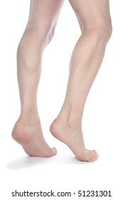 Woman legs and feet isolated over white background