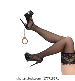 Woman legs with handcuffs, isolated on white, desire