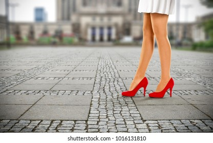 woman legs and heels of red color. Free space for your decoration.