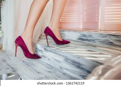 Woman  legs in high heeled shoes on the stairs! Fashion concept!