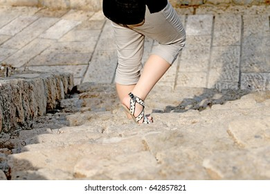 woman legs on background stairs for advertising