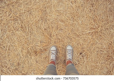 woman legs on straw floor