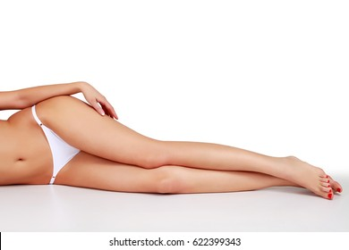 Woman legs on white background, isolated