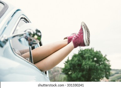 Woman legs outside a vintage car. concept about carefree and freedom