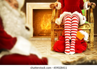 woman legs in red and white pantyhose and santa claus