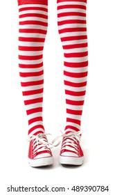 Woman legs in socks on white background