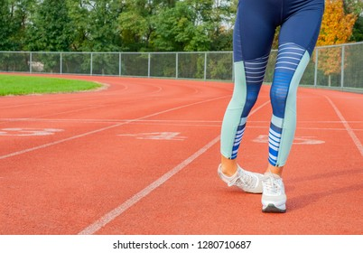 Woman legs stumbling on the run track during running