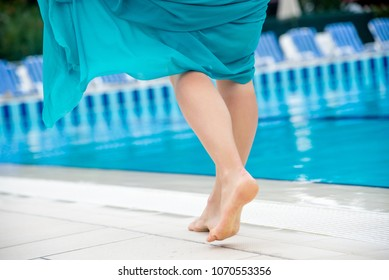 Woman legs in a swimming pool.