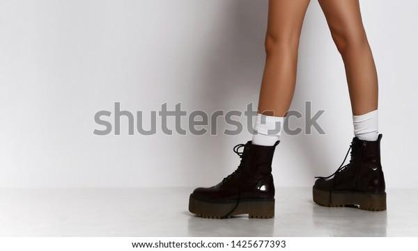 Woman Legs Walking Leather Black Boots