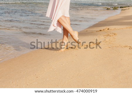 1670f108c ... Stock Photo (Edit Now) 474000919 - Shutterstock. Woman legs walking on  the beach sand
