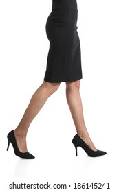 Woman legs walking with pencil skirt and nylons isolated on a white background